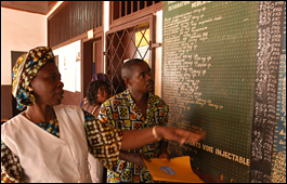 Health workers looking at the price list at a health care clinic in Central African Republic.