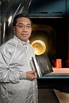 Astrophysicist Will Zhang and his X-ray mirror