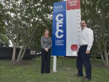 Langley Director Lesa Roe (L) and CFC Chair George Finelli stand beside a CFC goal marker
