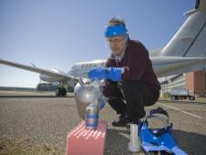 Mike Dobbs pours liquid nitrogen which will cool the laser detector in flight
