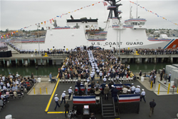 Crewmembers of the Coast Guard Bertholf rush to man the rails