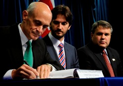 Secretary Chertoff, Slovak Republic Minister of Interior Robert Kalinak and DOJ Deputy Attorney General Mark Filip sign an agreement to enhance cooperation on preventing and combating crime with the Slovak Republic.