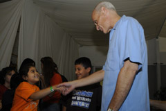 Secretary Michael Chertoff talks with a young lady at the Lindale Assembly Church in Houston, Sept. 17.