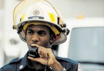 Firefighter speaking into walkie-talkie.