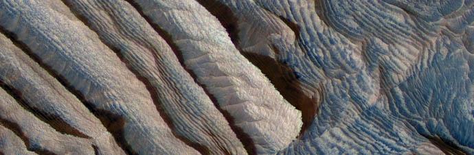 Rhythmic bedding in sedimentary bedrock within Becquerel crater on Mars