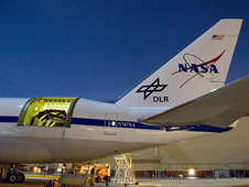 SOFIA's infrared telescope in the rear fuselage during nighttime testing.