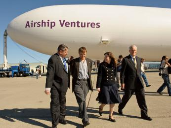 NASA Ames Center Director, Dr. S. Pete Worden, Brian and Alexandra Hall, and Colonel (USMC Retired) William Moffett III enjoyed the celebration of Airship Ventures Dedication at the Moffett Field 75th Anniversary.