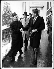President-elect John F. Kennedy shakes hands with Father Richard J. Casey, the Pastor, after attending Mass at Holy Trinity Church prior to inauguration ceremonies, January 20, 1961 (Library of Congress)