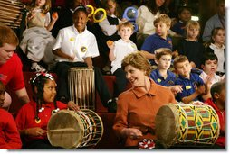 Mrs. Laura Bush joins in a musical number playing a drum with children at the Louisiana Children's Museum in New Orleans, Tuesday, Jan. 9, 2007, during her visit to see the rebuilding progress in the Gulf Coast region. The museum, closed nearly a year following the 2005 hurricanes, is working to address the needs of young children and families seeking a safe and nurturing environment.  White House photo by Shealah Craighead