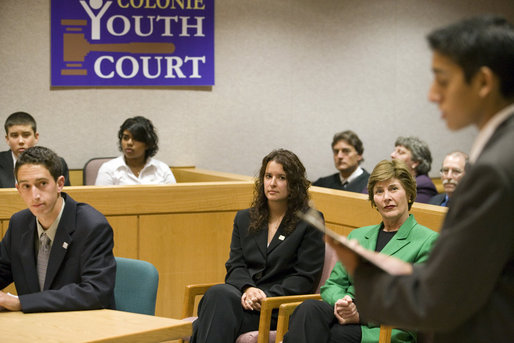 As part of the President's Helping America's Youth initiative, Mrs. Laura Bush observes a mock trial at the Colonie Youth Court in Latham, New York, Wednesday, October 4, 2006. The Colonie Youth Court has been recognized by the U.S. Department of Justice as a national model of effective programming to help at-risk youth. The court has been replicated in more than 80 communities in the state of New York. White House photo by Shealah Craighead