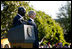 President George W. Bush stands with President John Agyekum Kufuor of Ghana Monday, Sept. 15, 2008, during a South Lawn Arrival Ceremony for the African leader at the White House.