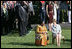 Mrs. Laura Bush and Ghana's first lady Theresa Kufuor sit together on the South Lawn of the White House during the South Lawn Arrival Ceremony Monday, Sept. 15, 2008, on the South Lawn of the White House.