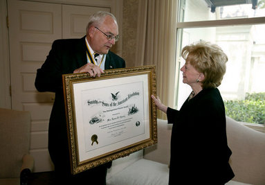 Mrs. Lynne Cheney is presented the National Society Sons of the American Revolution (NSSAR) Distinguished Patriot Award by Timothy R. Bennett, NSSAR Registrar General, Wednesday, July 30, 2008, at the Vice President's Residence at the Naval Observatory in Washington, D.C. White House photo by David Bohrer