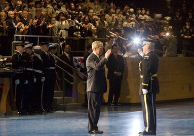 President George W. Bush salutes Col. Joseph Buche, Commander of Troops at Ft. Myer, Va., after reviewing the troops Tuesday, Jan. 6, 2009, during a military appreciation in the President's honor as Commander-in-Chief. White House photo by Joyce N. Boghosian