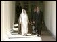 President George W. Bush and Prime Minister Sheikh Sabah al Ahmad al-Jabir Al Sabah of Kuwait walk along the colonnade after the two leaders met with reporters in the Oval Office Wednesday, Sept. 10, 2003.  White House photo by Paul Morse
