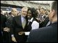 President George W. Bush greets the audience following remarks at the Indiana Black Expo Corporate Luncheon in Indianapolis, Indiana, Thursday, July 14, 2005.  White House photo by Eric Draper