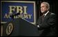 """President George W. Bush delivers remarks about key accomplishments and the ongoing efforts in the war on terrorism during a visit Monday, July 11, 2005, to the FBI Academy in Quantico, Va. Said the President, """"The FBI efforts are central to our success in the war on terror. And I thank you for that.""""  White House photo by Eric Draper"""