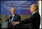 President George W. Bush laughs at a comment by Russian President Vladimir Putin during a question and answer session with students at St. Petersburg State University in St Petersburg, Russia on May 25, 2002.