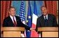 President George W. Bush answers questions at a press conference with French President Jacques Chirac at the Elysee Palace in Paris, France on May 26, 2002.