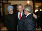 President George W. Bush embraces India's Prime Minister Dr. Manmohan Singh, left, and Brazilian President Luiz Inacio Lula da Silva, right, at the Konstantinovsky Palace Complex Monday, July 17, 2006. President Bush met with the two leaders separately in bilateral meetings during the G8 Summit in Strelna, Russia.  White House photo by Eric Draper