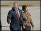 President George W. Bush and Laura Bush walk across the tarmac to Air Force One before departing Buckley Air Force Base in Aurora, Colo., Monday, Oct. 25, 2004.  White House photo by Eric Draper