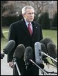 """President George W. Bush speaks to the media Thursday, Dec. 22, 2005, on the South Lawn of the White House before leaving for Camp David. The President spoke about the Patriot Act extension saying, """"We're still under threat, there's still an enemy that wants to harm us and they understand the Patriot Act is an important tool for those of us here in the Executive Branch to use to protect our fellow citizens.""""  White House photo by Kimberlee Hewitt"""