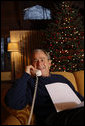 President George W. Bush makes Christmas Eve telephone calls to members of the Armed Forces, Wednesday, Dec. 24, 2008, from Camp David. White House photo by Eric Draper