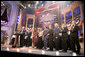 """President George W. Bush and Mrs. Laura Bush are joined on stage by the cast of entertainers performing at the annual Ford's Theater gala to benefit the historic theater. The program, """"An American Celebration at Ford's Theater,"""" will be televised on July 4, 2006. White House photo by Kimberlee Hewitt"""