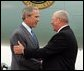 President George W. Bush chats with Freedom Corps greeter Charlie Graas after touching down in Springfield, Missouri on Friday July 30, 2004.  White House photo by Paul Morse
