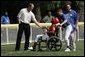 Former Major League pitcher Jim Abbott congratulates a player from the Challenger Phillies from Middletown, Delaware at Tee Ball on the South Lawn at the White House on Sunday July 11, 2004.  White House photo by Paul Morse