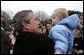 Welcomed by an enthusiastic crowd, President George W. Bush holds a child during an airport arrival greeting at RAF Aldergrove airport in Northern Ireland, Monday, April 7, 2003.  White House photo by Eric Draper