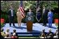President George W. Bush discusses the economy in the Rose Garden Tuesday, April 15, 2003. Accompanying President Bush on stage are, from left, small business owners Tim Barrett, Christine Bierman, Frank Fillmore and Karla Aaron.  White House photo by Paul Morse