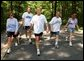 President George W. Bush and First Lady Laura Bush complete a four mile walk with brother Marvin Bush, left, Chief of Staff Andy Card and wife Kathleene after undergoing a colorectal screening procedure at Camp David, Saturday morning, June 29.