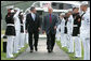 President George W. Bush and Prime Minister Gordon Brown of the United Kingdom, walk past an honor guard Sunday, July 29, 2007, after the Prime Minister's arrival at Camp David in Thurmont, Maryland. White House photo by Chris Greenberg