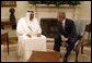 """President George W. Bush meets with Amir Hamad bin Khalifa Al Thani of Qatar in the Oval Office Thursday, May 8, 2003. """"I would like to thank the President very much for his gracious invitation for me to come and meet with him here at the White House,"""" said the Amir during the two leaders' address to the media. """"We in Qatar are very keen to have a very unique and strong and distinct relationship with the United States, a relationship that it is transparent.""""  White House photo by Paul Morse"""