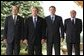 President George W. Bush poses with G8 leaders during the G8 Summit in Evian, France, Monday, June 2, 2003. From left, President Jacques Chirac of France, President Bush, Prime Minister Tony Blair of Great Britain and Prime Minister Silvio Berlusconi of Italy.  White House photo by Eric Draper