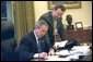 As pictured in the attached file photo, President George W. Bush works on a press statement with Principal Deputy White House Press Secretary Scott McClellan in the Oval Office Nov. 7, 2002. President Bush announced today that he will name Scott McClellan to be Assistant to the President and White House Press Secretary. Currently, Mr. McClellan is Deputy Assistant to the President and the Principal Deputy White House Press Secretary. He will succeed current White House Press Secretary Ari Fleischer, who has announced that he will depart the White House next month.  White House photo by Eric Draper
