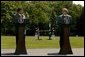 """Presidents Pervez Musharraf of Pakistan and George W. Bush hold a joint press conference at Camp David Tuesday, June 24, 2003. """"Greater economic development is also critical to fulfilling the hopes of the Pakistani people,"""" said President Bush. """"Since we met last year, the United States has cancelled $1 billion of debt Pakistan owed our country. And today I'm pleased to announce that our nations are signing a trade and investment framework agreement, which creates a formal structure for expanding our economic partnership.""""  White House photo by David Bohrer"""