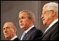 """President George W. Bush reads from a joint statement by Israeli Prime Minister Ehud Olmert and Palestinian President Mahmoud Abbas, in which the leaders pledged to resume Mideast peace talks. The statement came during the Annapolis Conference in Annapolis, Maryland, and read, in part: """"We express our determination to bring an end to bloodshed, suffering and decades of conflict between our peoples; to usher in a new era of peace, based on freedom, security, justice, dignity, respect and mutual recognition; to propagate a culture of peace and nonviolence; to confront terrorism and incitement, whether committed by Palestinians or Israelis."""" White House photo by Chris Greenberg"""