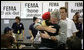 President George W. Bush hugs an unidentified woman Thursday, Oct. 25, 2007, at a FEMA emergency center in Rancho Bernardo, California. The President visited the Southern California area hard hit by recent wildfires, consoling those who lost their homes and commending those whose efforts saved others. White House photo by Eric Draper