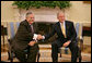 President George W. Bush and President Jalal Talabani of Iraq, shake hands Tuesday, Oct. 2, 2007, as they meet in the Oval Office. White House photo by Eric Draper