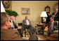 """President George W. Bush discussed the economy with the press Friday, Oct. 5, 2007, in the Oval Office. Pictured with the President are, from left: OMB Director Jim Nussle, CEA Chairman Ed Lazear and NEC Director Al Hubbard. """"I want to thank members of my economic team for coming in the Oval Office this morning to bring some good news here for America's families and America's working people. The -- last month our economy added 110,000 new jobs,"""" said President Bush. """"And that's good news for people here in our country. It's an indicator that this economy is a vibrant and strong economy."""" White House photo by Eric Draper"""