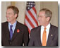 """President George W. Bush and Prime Minister Tony Blair of England walk out to address the media in Cross Hall at the White House Nov. 7. """"We've got no better friend in the world than Great Britain,"""" said the President during his remarks. White House photo by Paul Morse."""