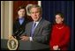 President George W. Bush gives remarks on the economy with members of tax families present in room 450 of the Eisenhower Executive Office Building on February 19, 2004.  White House photo by Paul Morse