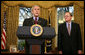 """With Michael McConnell, Director of National Intelligence, looking on, President George W. Bush delivers a statement on the Protect America Act Wednesday, Feb. 13, 2008, in the Oval Office of the White House. Said the President, """"It is time for Congress to ensure the flow of vital intelligence is not disrupted. It is time for Congress to pass a law that provides a long-term foundation to protect our country. And they must do so immediately.""""  White House photo by Joyce N. Boghosian"""
