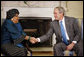 "President George W. Bush shakes hands with Liberia President Ellen Johnson Sirleaf following their meeting Wednesday, Oct. 22, 2008, in the Oval Office at the White House. President Bush said to President Sirleaf, ""I have come to respect you and admire you because of your courage, your vision, your commitment to universal values and principles."" White House photo by Eric Draper"