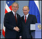 President George W. Bush and Russia's President Vladimir Putin shake hands after their joint press availability Sunday, April 6, 2008, at Bocharov Ruchey, President Putin's summer Presidential retreat in Sochi, Russia.  White House photo by Chris Greenberg