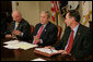 President George W. Bush is joined by Secretary of Energy Samuel Bodman, left, and FEMA Administrator David Paulison, right, as he speaks to the press from the Roosevelt Room following a briefing on the latest developments concerning Hurricane Ike, Sunday, Sept. 14, 2008. White House photo by Chris Greenberg