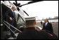 President George W. Bush is welcomed by United Nations U.S. Ambasador Dr. Zalmay Khalilzad as he arrives Monday, Sept. 22, 2008, aboard Marine One at the Wall Street helicopter landing area in New York City. President Bush will address the United Nations General Assembly on Tuesday. White House photo by Eric Draper