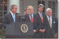 President Bush speaks at bill signing ceremony.